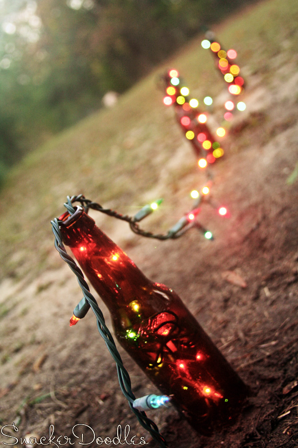 Save money by creating your own outdoor christmas for Beer bottle decoration ideas