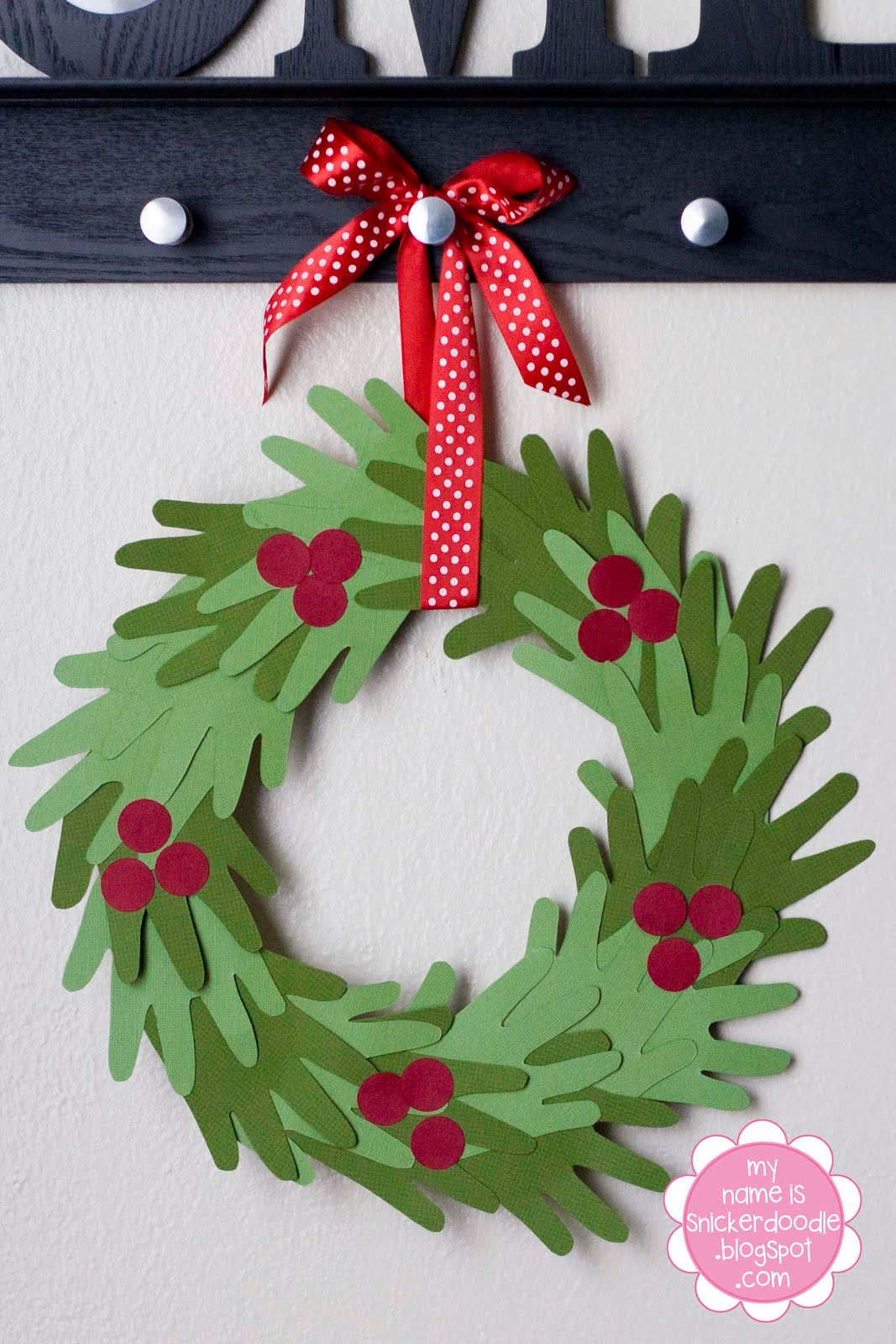 a simple and clever cutting of some card stock is all you need to bring a winsome wreath to life perfect to use as a cute element of your christmas
