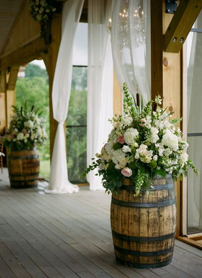 Wine Barrels Decorated With Colorful Flower Bouquets