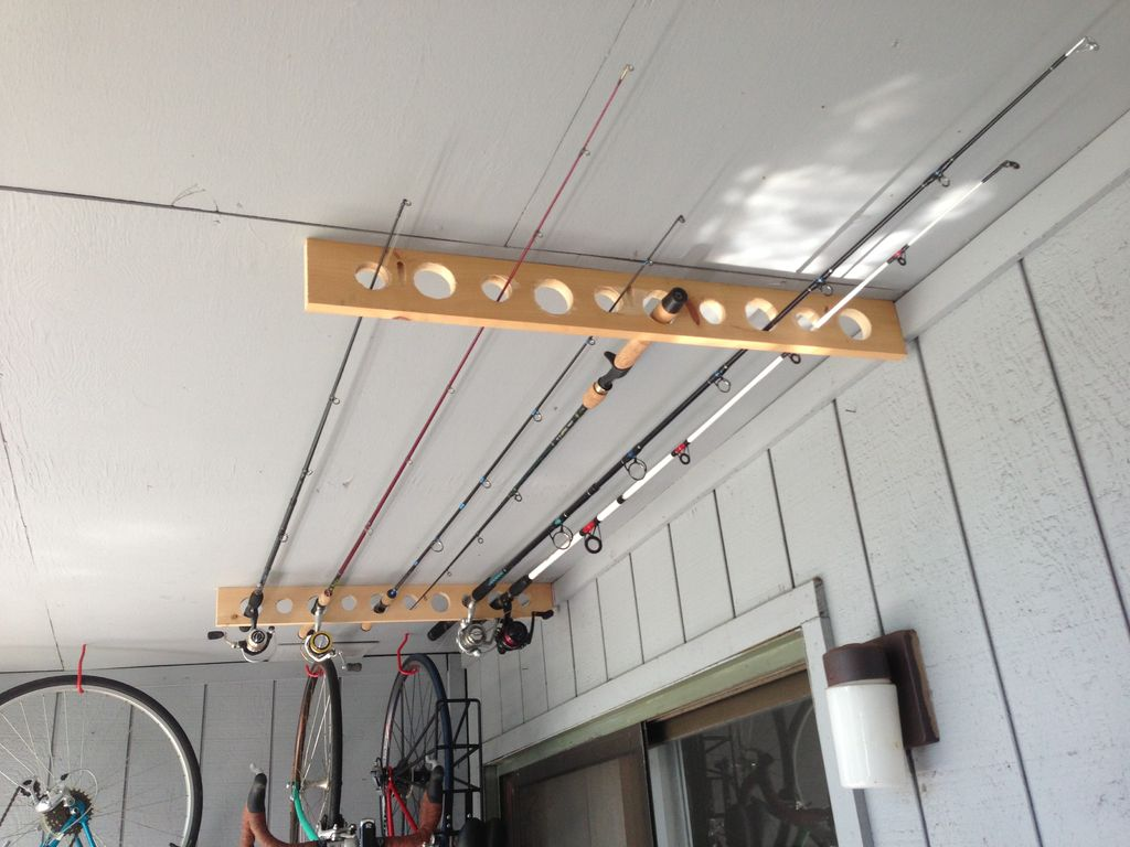 35 diy garage storage ideas to help you reinvent your for Homemade fishing rod storage ideas