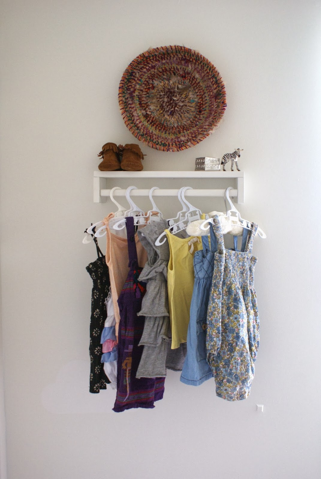 Easy Dress Storage Idea For Your Baby Girl's Clothes!