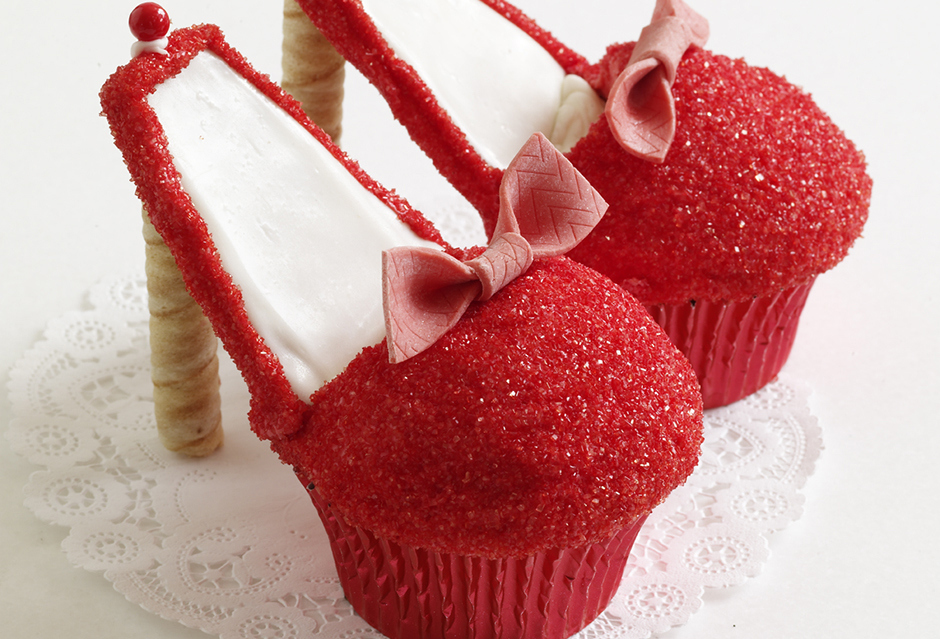 Red Stiletto Cupcakes With A Lovely Ribbon Decoration