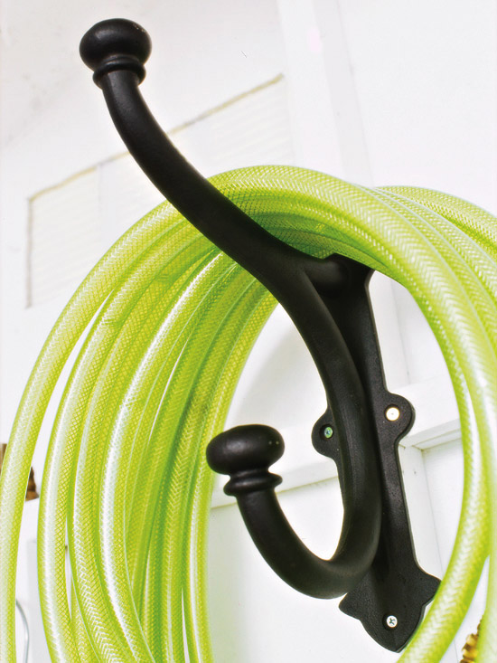 Garden Hose Storage Ideas the decorative coiled hose garden storage beckons you to pause and sit awhile in the garden Store Your Garden Hose The Easy Way