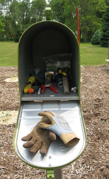 Use Your Garden Mailbox As Your Toolshed