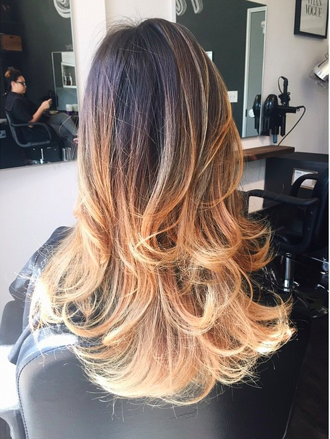 The ombre here is one that is placed on long hair. This really allows the hair to show off its length through the gradient. The dark brown roots transition