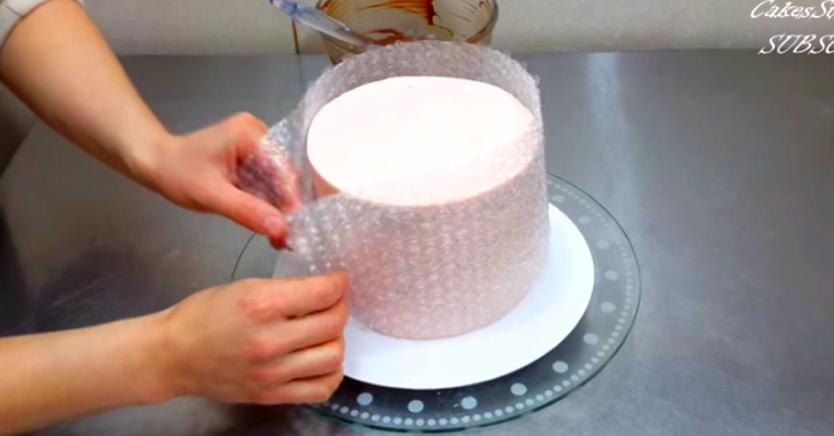 What She Creates Putting Bubble Wrap Around A Cake Is