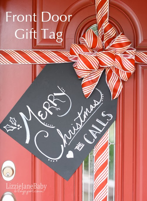gift wrapped front door with tag
