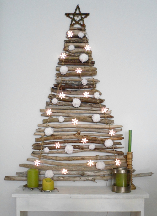 30 diy christmas tree ideas to go a little unconventional this wood branch christmas tree solutioingenieria Choice Image