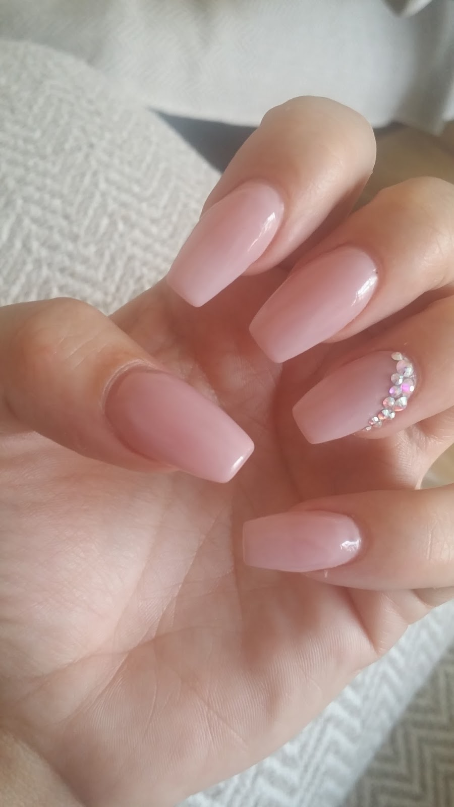 Tapered Pink Nails With Bright Crystals