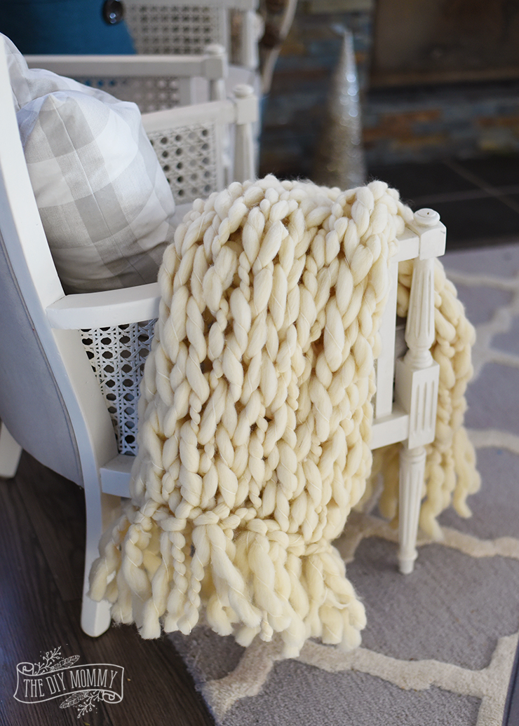 Arm Knit Blanket with a Fringe