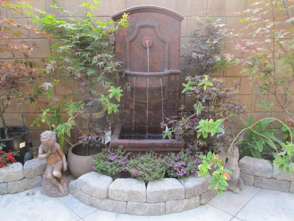 20 diy outdoor fountain ideas brightening up your home for Outdoor wall fountains