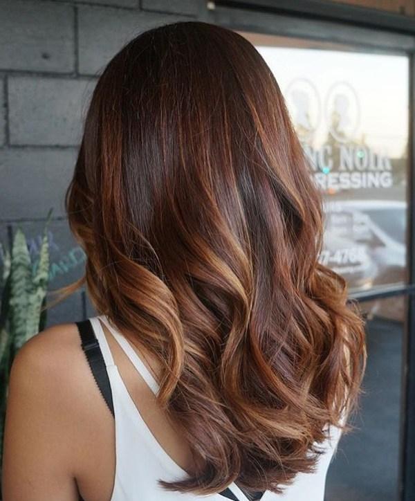 Long Tousled Hair with Auburn Highlights